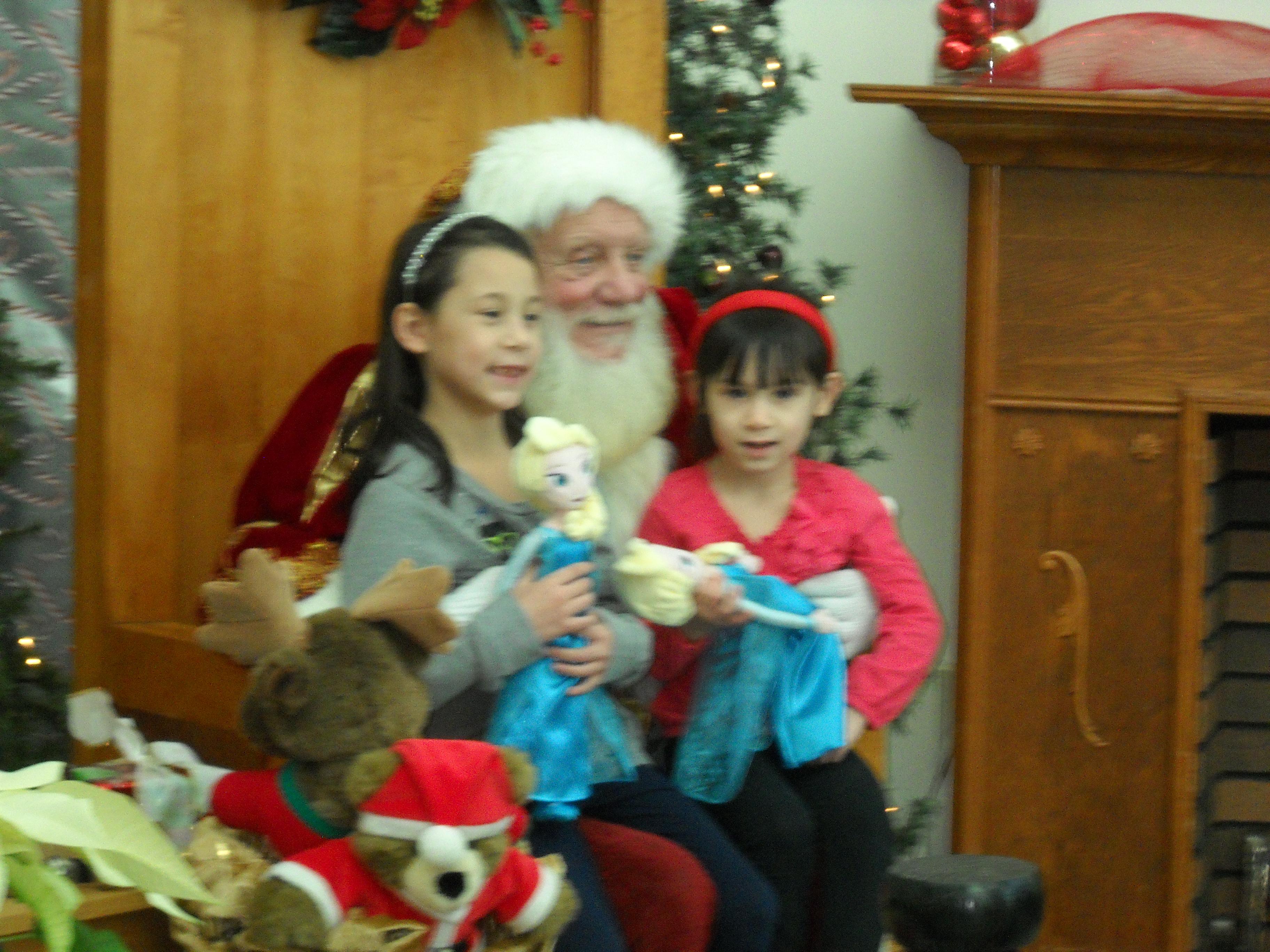 Little girls with Frozen dolls